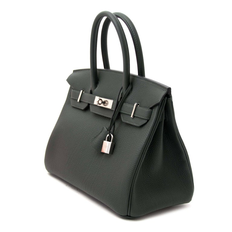 Never used  Hermès Birkin 30 Togo Vert Fonce PHW  This beautiful Birkin bag comes in a forest green, called 'Vert Fonce' ( very wanted!) featuring a contrasting palladium hardware. Togo leather is an incredibly popular leather, it's almost entirely