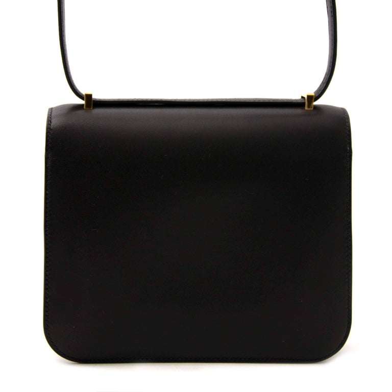 Never Used  Hermès Black Constance Mini Constance Mini Veau Evercalf GHW Veau evercalf is similar in appearance and behavior to Box Calf, but softer to the touch.  The Constance is a simply, elegant shoulder bag with a long leather strap that can be