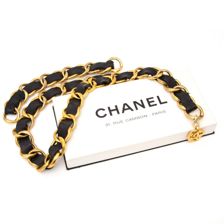 Chanel Black Vintage Leather Weave Swag Belt   This fabulous black Chanel weave belt is made out of gold toned oval links featuring black leather treads. The long leather weave hanging section hooks onto the lower level of the belt to create a swag