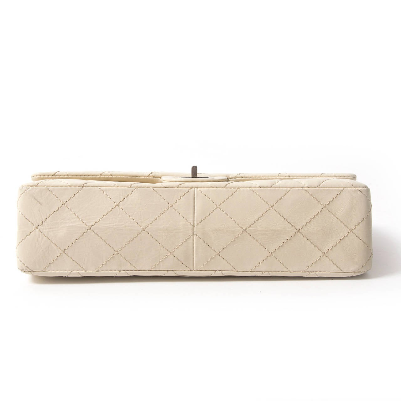 Chanel Snow White 2.55 Medium Reissue  The Chanel 2.55 Flap Bag is one of the most coveted bags of all time.  In the 1920s, Coco Chanel has designed the classic flap bag to make her hands move freely during social events. As she made her return