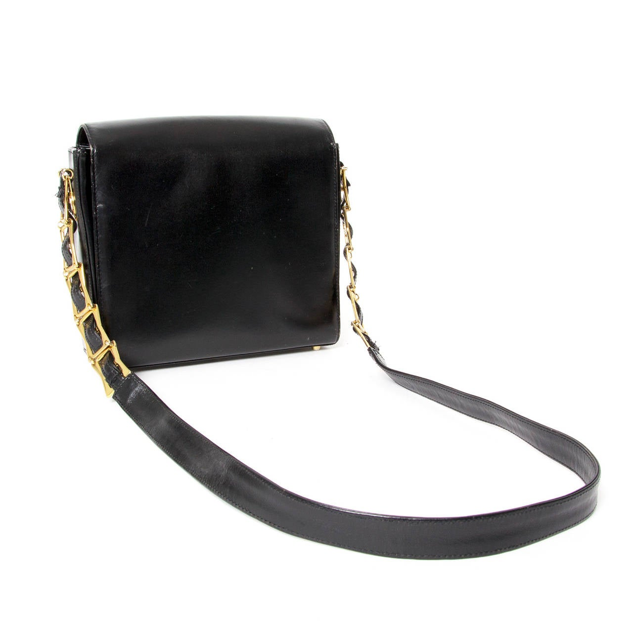 Gianni Versace Black Leather Medusa Handbag  Beautiful vintage Gianni Versace handbag with golden Medusa logo on the front and on the sides.   The bag is easy to wear thanks to the black leather with goldplated chain shoulderstrap. It can be