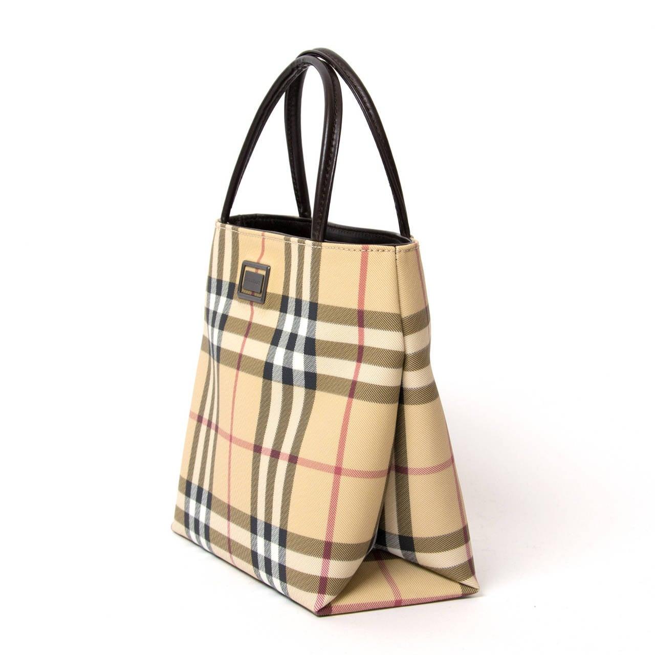 Burberry Coated canvas Nova Handbag. Dark Brown handles.  Magnetic closure, burberry interior lining, one inside zipper pocket.
