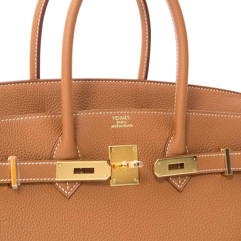 8c3845a9fad This is a Hermès Birkin bag in the luxurious color  Gold . Tonal hardware