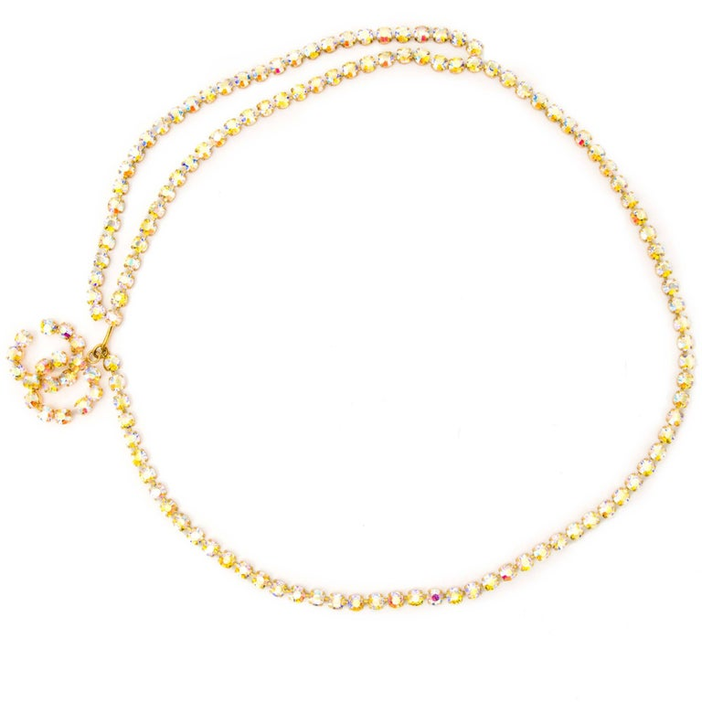 Chanel Vintage Aurora Stone Chain Belt  Worn by Linda Evangelista in the nineties on the runway, this Chanel Vintage Aurora stone chain belt is a rare collectors item!  This belt comes in gold with Aurora stones and has the interlocking CC logo as a