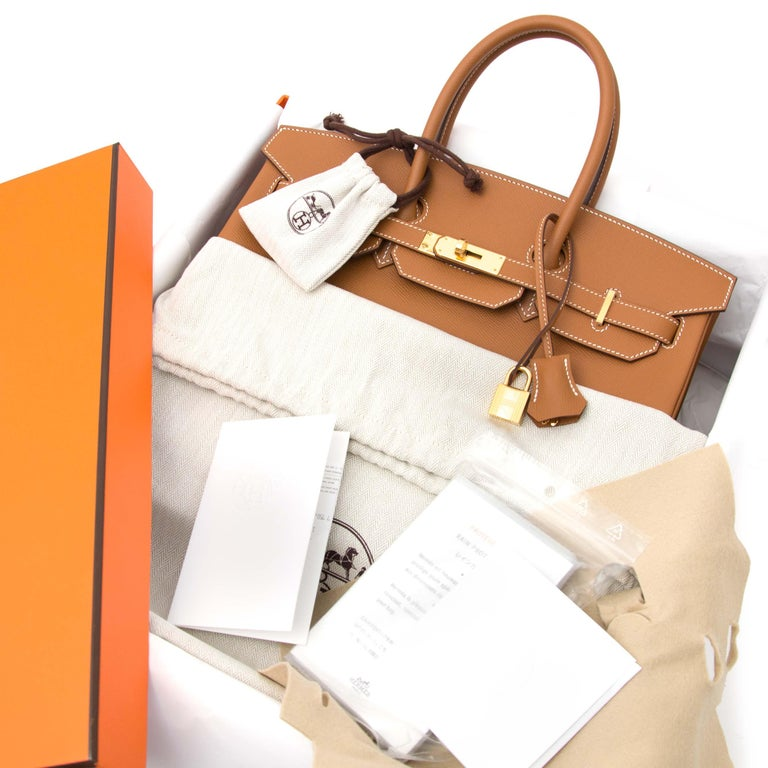 Exquisite Hermès Birkin, straight from the shop and never been carried. Skip the years-long waiting list and get your hands on this precious item. This beauty is crafted out of striking gold epsom leather and finished off with gold toned hardware. A