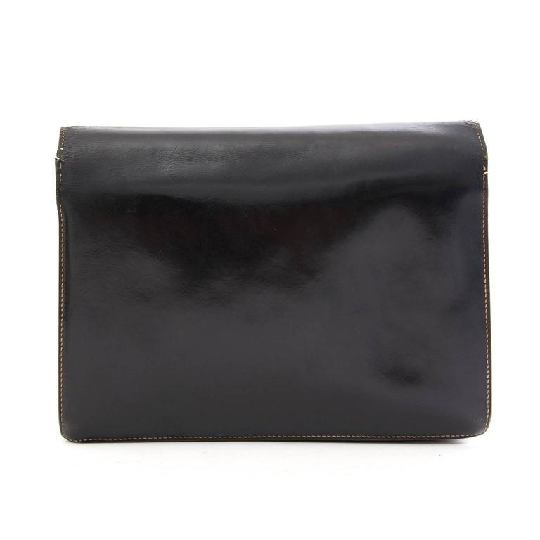 Black Hermès 'Faco' clutch bag  This Hermès 'Faco' clutch comes in black leather, making it the perfect bag for any occasion.  Contains three smaller pockets on the inside. There are some signs of use and little scratches as shown in