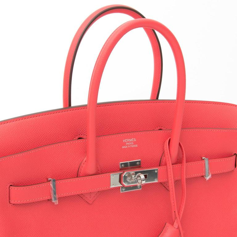 This is a brand new, storebought Hermès bag, handcrafted from Epsom leather, a grained leather type that keeps its upright structure.  The color is a lively, enchanting pink, Rose Jaipur, named after the famed Inidian city. The paladium