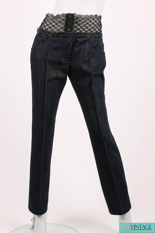 Chanel jeans with a twist from the Runway Collection of 2004!  This pair of jeans is sophisticated and should rather be called 'a pair of denim pants'. It is straight cut and has a seam in the middle of the leg. The dark blue jeans fabric has a