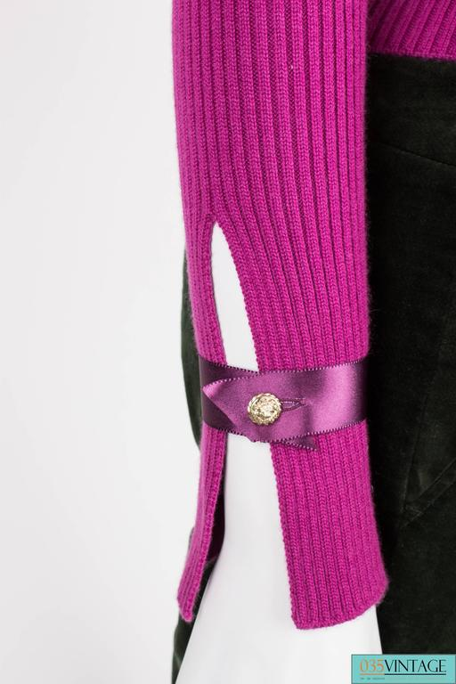 Beautiful purple turtle neck sweater by Chanel, fully made of ultra soft cashmere!  A turtle neck with a bow. At the back of the turtle neck you will find six golden buttons, a lionshead on them. A slit at the end of the long sleeves and a dark