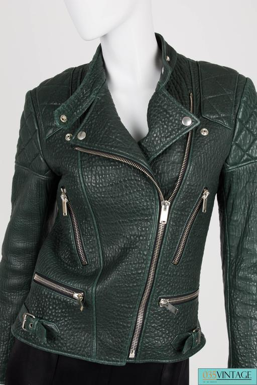 Very rare deep forest green shrunken kangaroo leather biker jacket designed by Phoebe Philo for CelineOn the shoulders, top of the back and elbows quilted pieces of leather for that extra tough look. Covered with silver zippers everywhere, also at