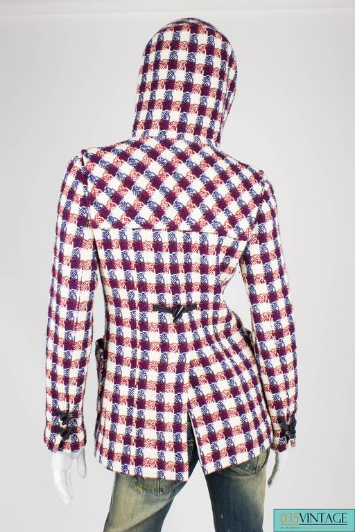Red, white and blue checkered hooded jacket by Chanel. 