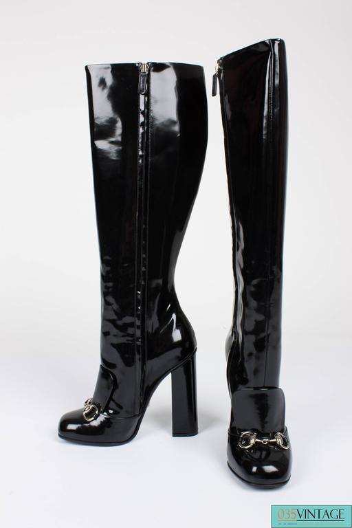 89a8ae92a Gucci Lillian boots in black patent leather, high heeled and a zipped