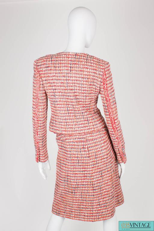 Stylish Chanel suit in a nice and warm color scheme; red, pink, gray,brown and white.