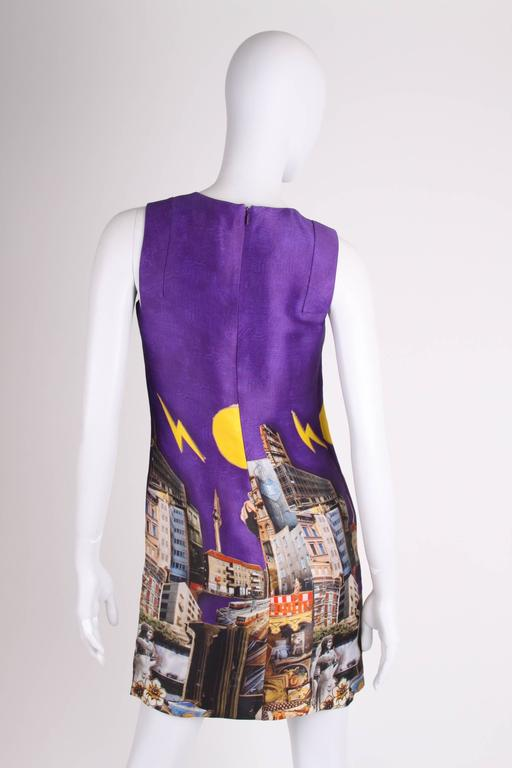 This Versace dress from the fall/winter collection of 2008 was designed by a very special couple: Donatella Versace and the Dutch artist Tim Roeloffs. Highly collectable!  The beautiful and colourful print is based on images of Berlin, the main