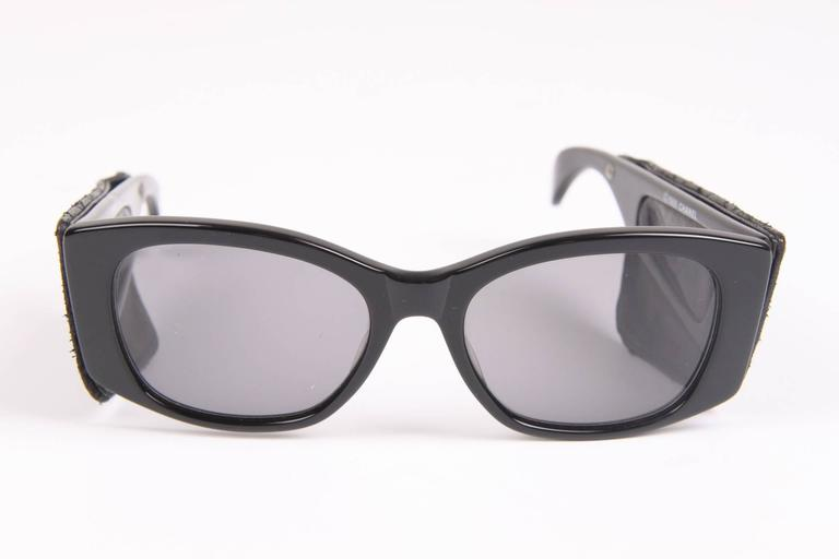 This is very special! With this pair of sunglasses the fashionhouse of Chanel started its (nowadays very expanded) collection of sunglasses in 1988.  The model is 0000, genuinly the very first one. Made of black acetate with dark lenses. The temples