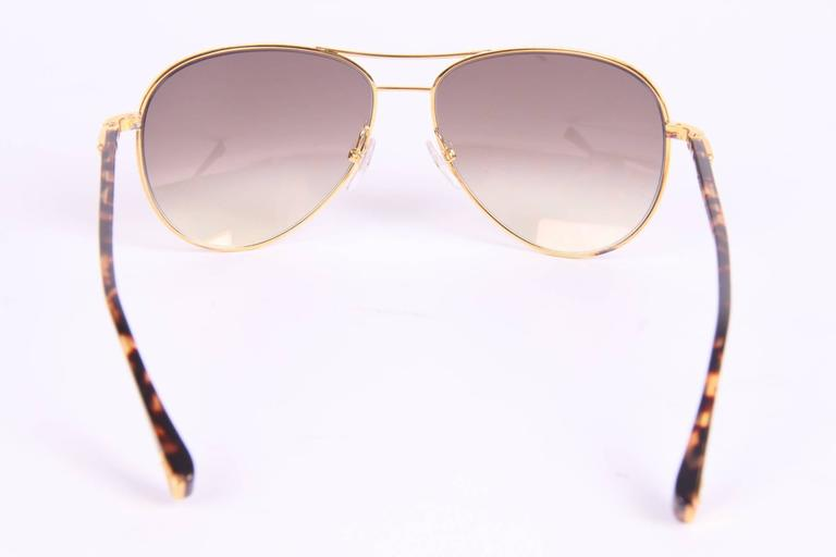 b07cca0ca33 Women s or Men s Louis Vuitton Conspiration Pilote Sunglasses - gold brown  For Sale