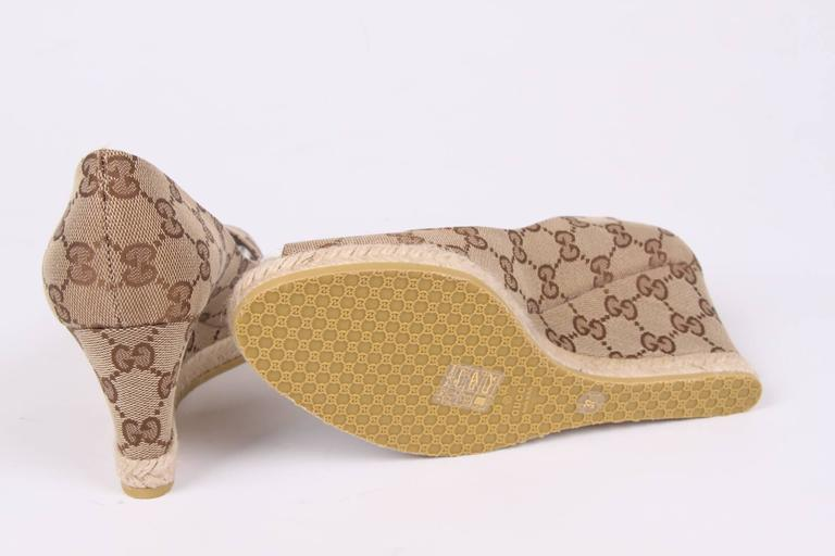 Comfortable summery wedge shoes by Gucci, nice!  Fully crafted in beige canvas covered with an ebony brown 'Guccissima' pattern. A peep toe, the heel measures 7,5 centimeters and a rubber outsole. Lining on the inside in dark brown leather.  New and