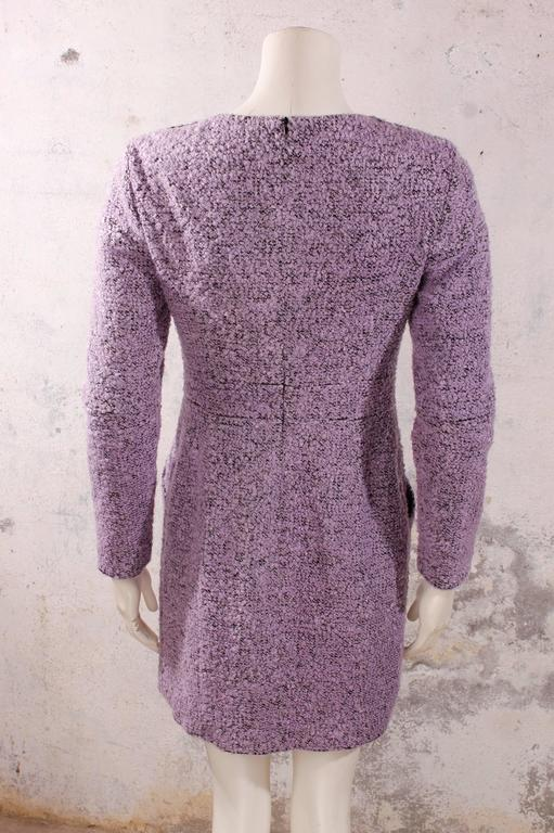 Purple / black boucle long-sleeved dress with 100% silk lining. Beautiful dress with decorative Gripox knots on the shoulders, two on both sides. Side pockets on the front that close with the same Gripox buttons. 