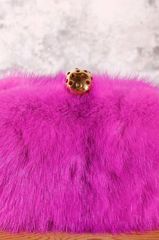 Alexander McQueen brings you the signature box clutch you love in sumptuous, premium mink— and bedecked with the house's signature skull clasp, of course.