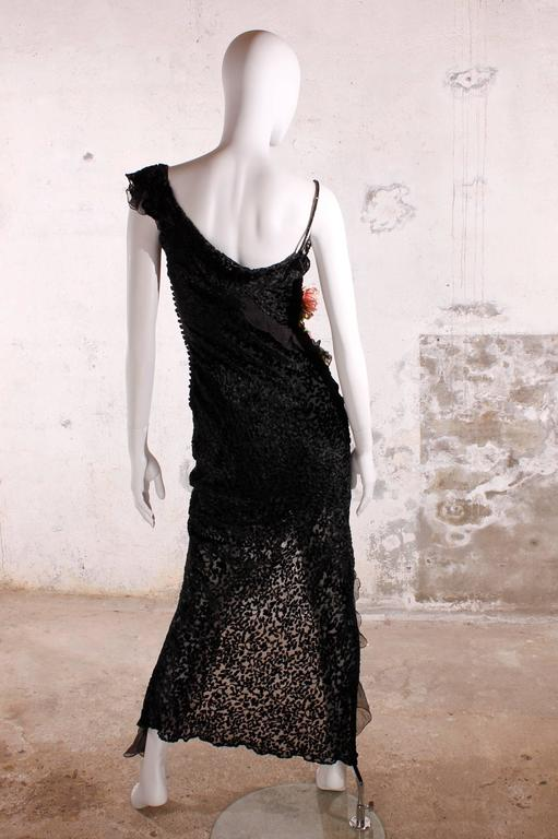 Very stylish and sexy Christian Dior dress! A small strap with black rhinestones on one side, on the other side a strap with ruffle trim and a small silk flower corsage.  On the right side a larger corsage made of various flowers in different