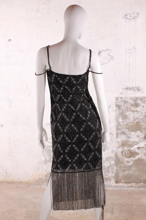 Stunning Christian Dior evening dress with a marvellous pattern, fully covered with beads and embroidery.