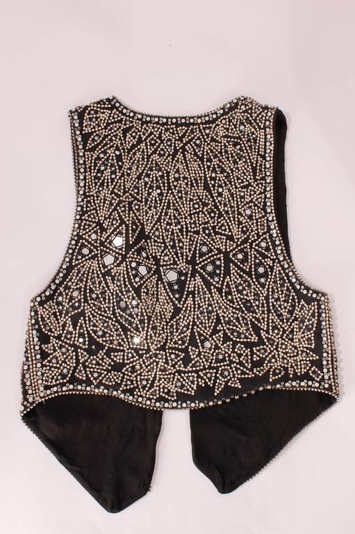 Black linen vest with a white and silver stone studded design.   French size 38  Never worn