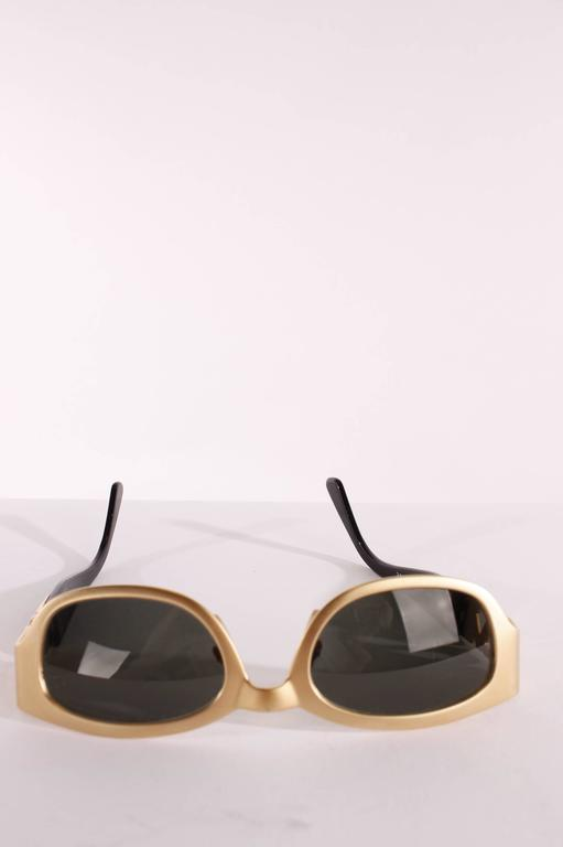 A vintage pair of sunglasses made by Luxottica for Yves Saint Laurent.
