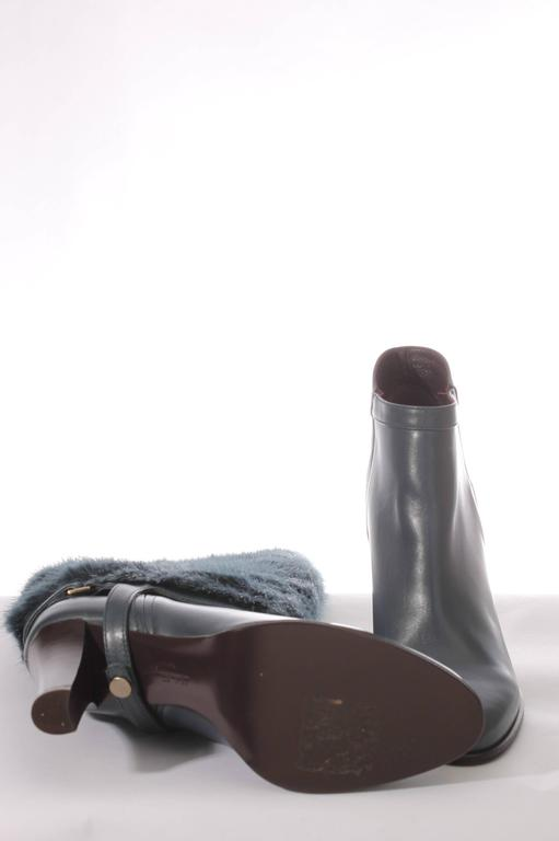 Petrol coloured leather Leonore Boots by Salvatore Ferragamo with a detachable mink shaft.  These boots are new and never been worn before, still in their original box with dustbag. Sole and heel undamaged, heel measures 8 centimeters. No plateau,