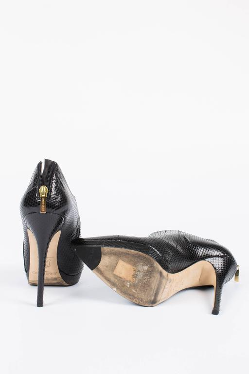 Skyhigh Jimmy Choo's in black watersnake leather, perfect for a night out!