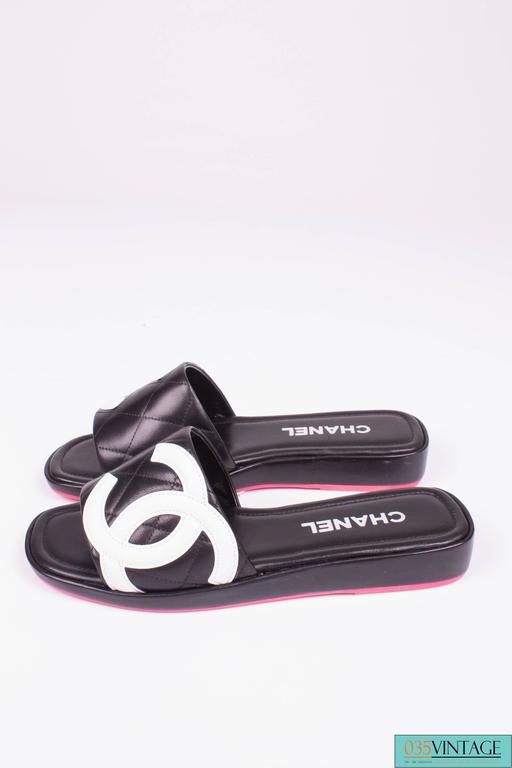 Chanel Quilted Cambon Slide Sandals Black And White