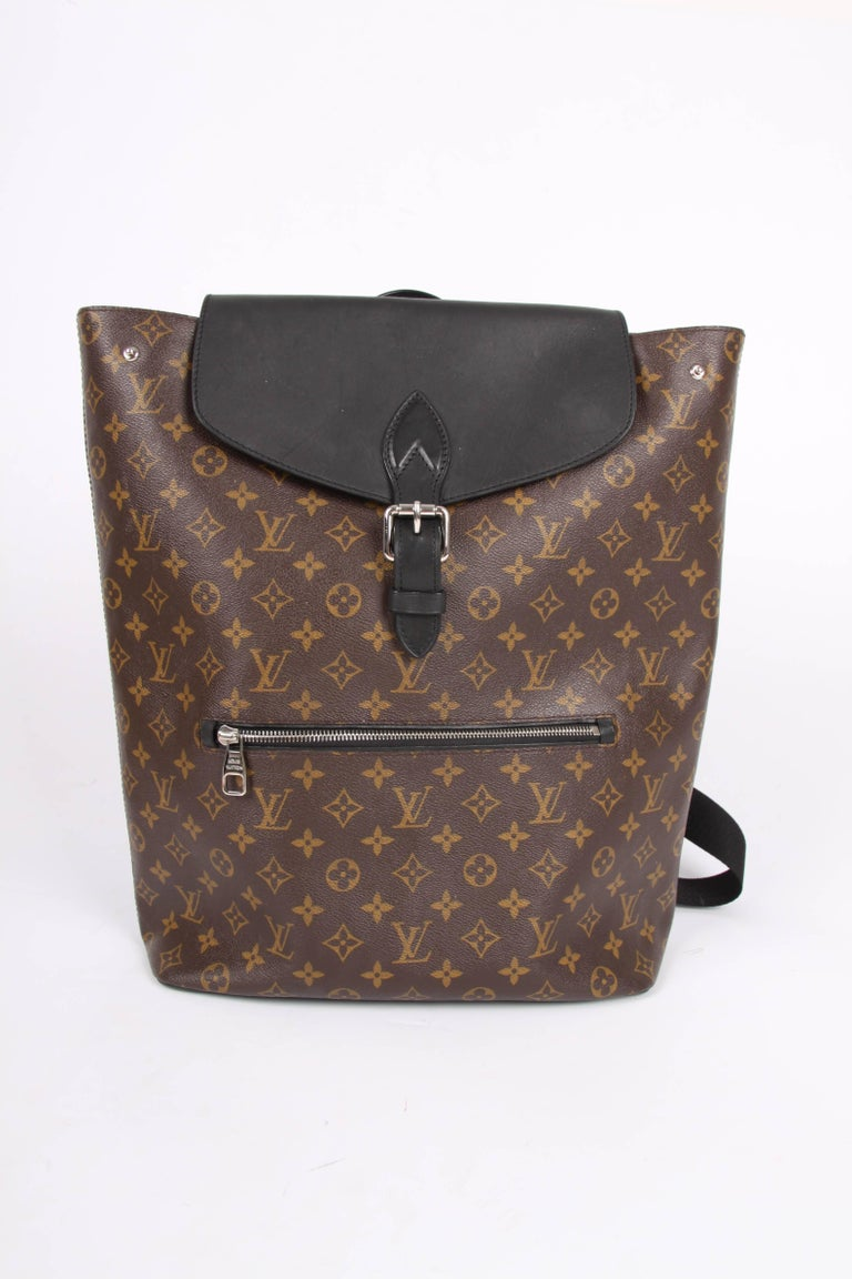 Large sized backpack with a modern shape; the Louis Vuitton Palk Backpack!  Of course crafted of dark brown canvas covered with LV monograms, the flap is made of black leather and decorated with silver-tone hardware. Black leather piping and softly