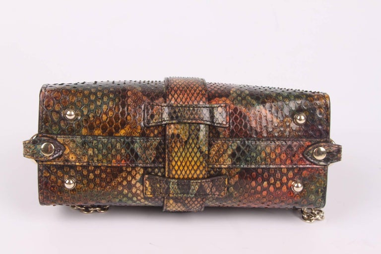 , what a beauty! Multi colour bag by Gucci crafted in python leather.  This is the Gucci Python Stirrup Top Handle Bag, this is the smallest size and it is rather rare. The larger size is available everywhere. This little cutie can even be worn