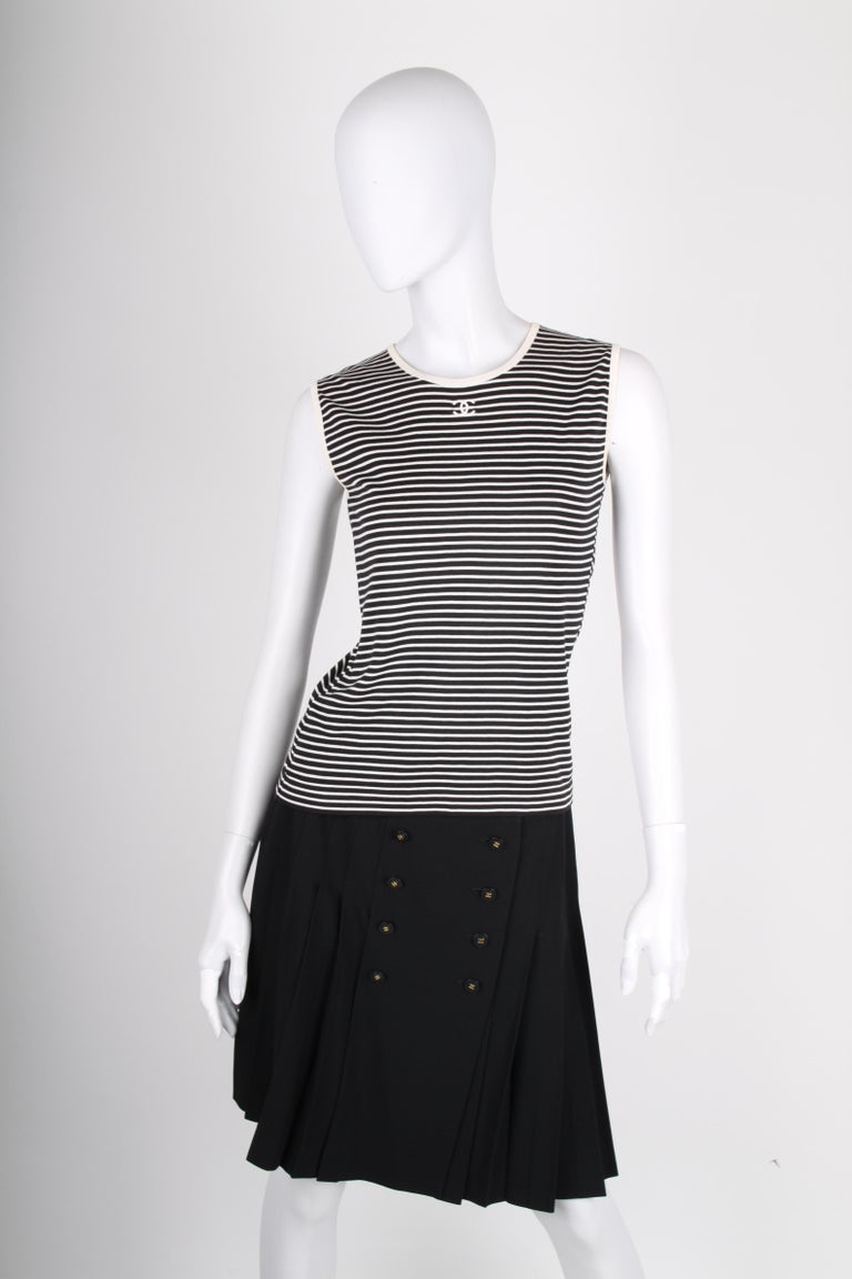 Classic black & white striped top by Chanel. Nice!  Sleeveless with a round neckline. Just below the neckline a white embroidered CC logo is applied. Stretching material, comfortable to wear.  In very good condition, 9,5/10. The size- and material