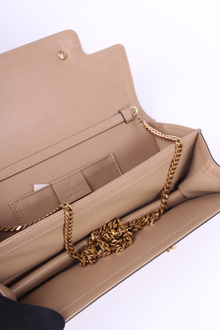 d393a73f208 From the Tigrette collection by Gucci  a beige nubuck leather clutch bag.  Fancy!