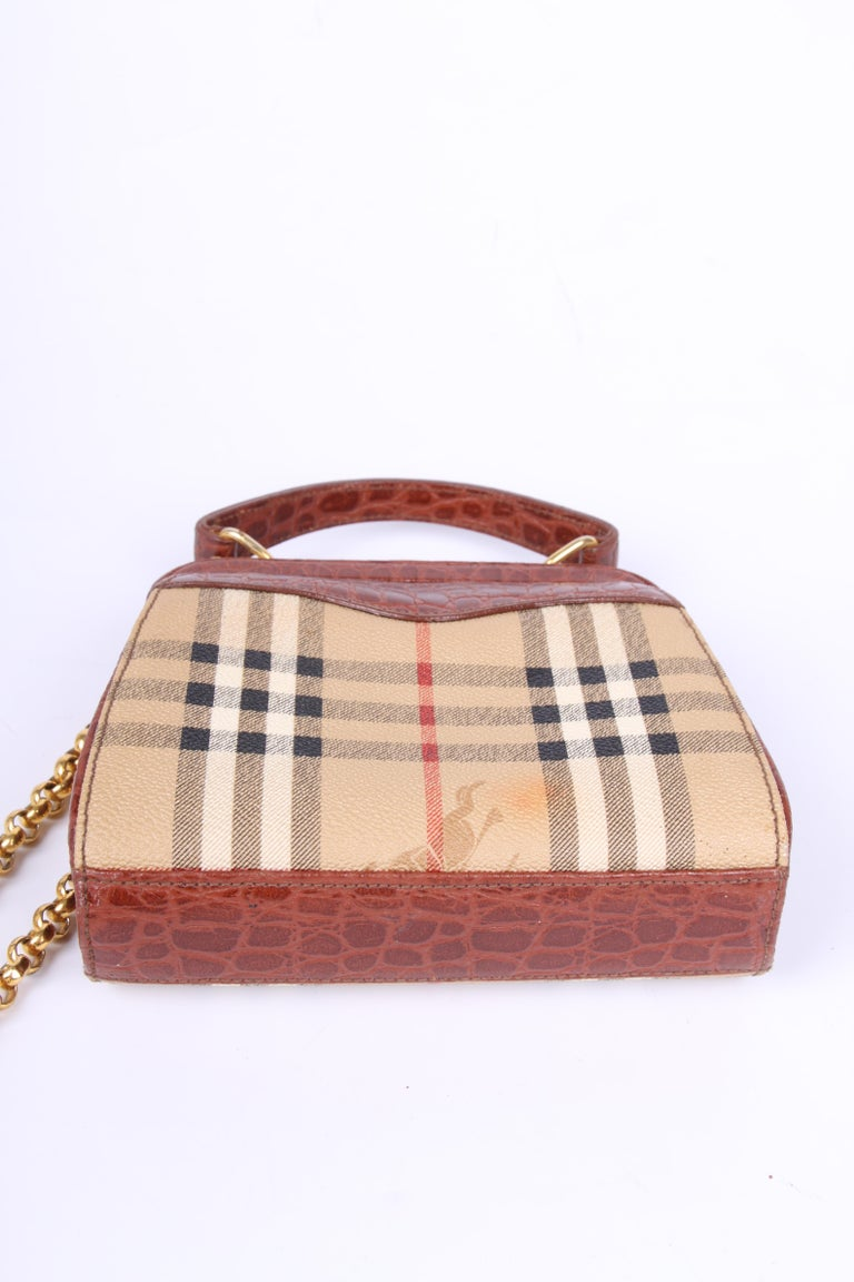 c627baf4f8 Vintage crossbody bag by Burberry. Adorable! This little model is of course  embellished with