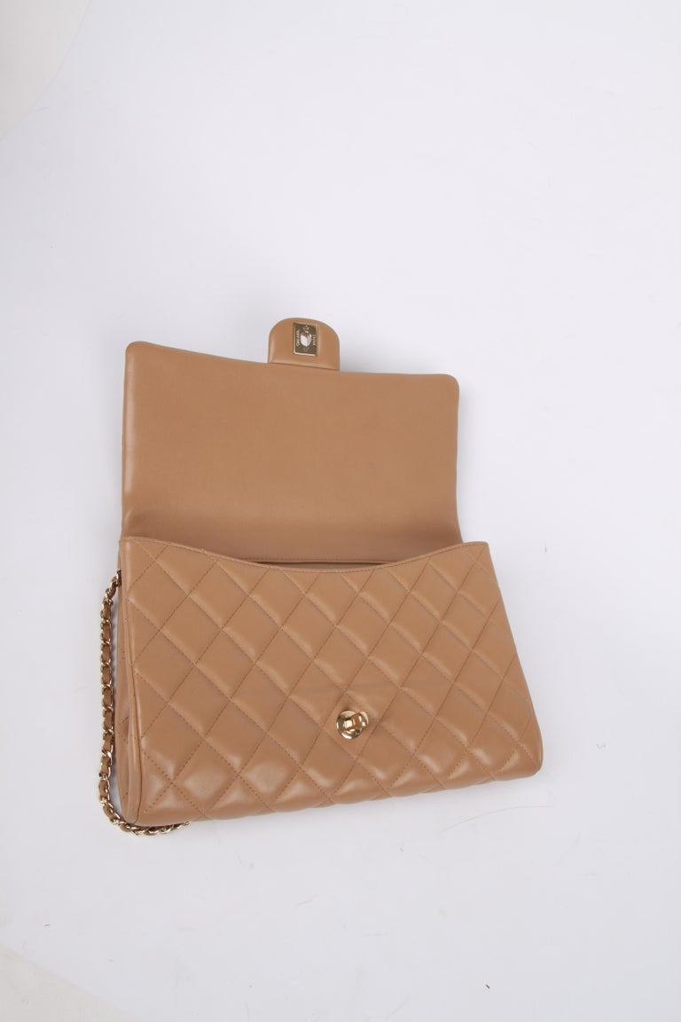 Women's or Men's Chanel Quilted Clutch with Chain - beige For Sale