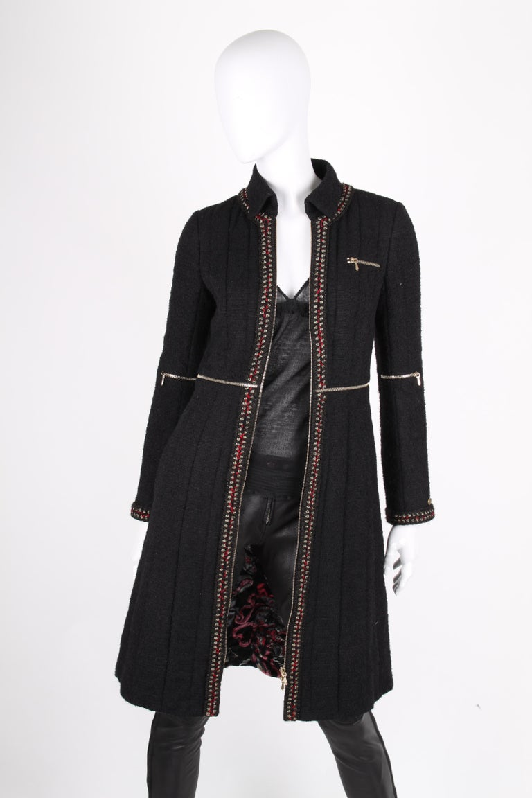 Very special Chanel coat from the pre-fall collection of 2010  A small round collar, long sleeves and zip closure at the front. A small zipped pocket on the left chest and welt pockets on hip height. Embellished with several silver-tone zippers; in