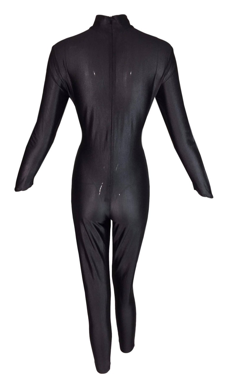 DESIGNER: 1990's Karl Lagerfeld  Please contact for more information and/or photos.  CONDITION: Excellent  MATERIAL: Sheer Nylon & Spandex  COUNTRY MADE: France  SIZE: 40- similar to a small to medium but is very stretchy and can be easily taken