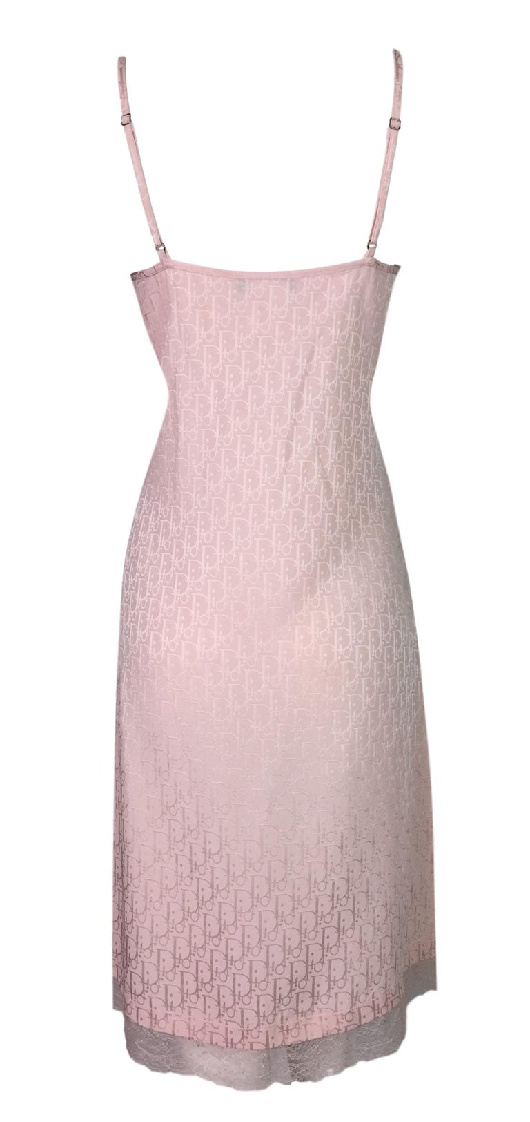 DESIGNER: S/S 2000 Christian Dior  Please contact for more information and/or photos.  CONDITION: Good- one tiny pin dot stain- please see last photo.   FABRIC: Acetate & Viscose  COUNTRY MADE: Italy  SIZE: 46  MEASUREMENTS; provided as a courtesy