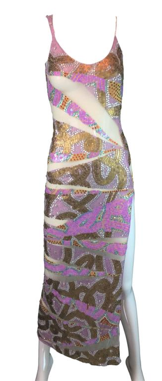 DESIGNER: S/S 2001 runway by Julien MacDonald  Please contact for more information and/or photos.  CONDITION:  Excellent  MATERIAL: Unknown- knit and mesh.  COUNTRY MADE: UK  SIZE: vintage size UK 10- runs extremely small- similar to an XXS/XS or