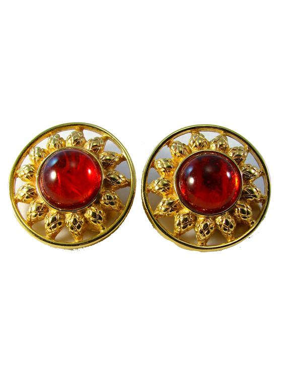 Incredible vintage earrings from Fendi feature a gold metal
