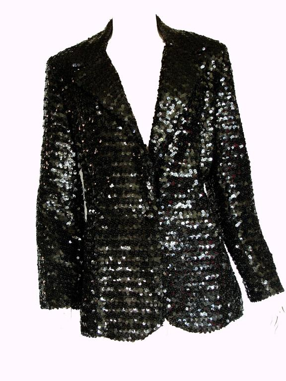 This sparkling jacket was made by Jack Hartley Miami in the late 1970s.  Fully-lined in black satin, it looks amazing with the sleeves rolled up and a pair of jeans.  In excellent vintage condition.  Small shoulder pads.  Fastens with a black resin