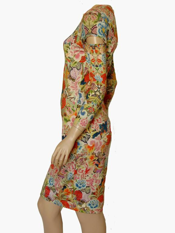 This chic dress is from Alexander McQueen from the pre SS14 collection and long sold out.  Patchwork floral print on jersey pencil dress with three quarter length slashed sleeves. In excellent preowned condition.  Material: 94% Rayon, 6% Elastane.