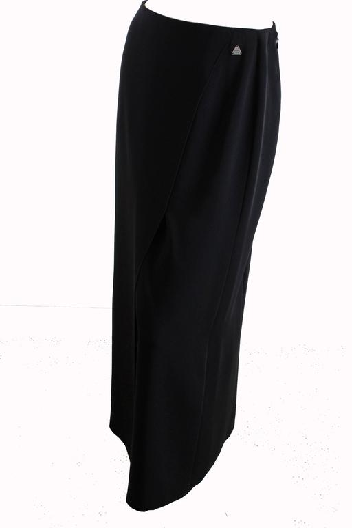 This light weight crepe maxi skirt is from Chanel, made for their 2000 resort collection.  It features faux-wrap styling and a sleek open vent in front.  Unlined and new with tags, it's in excellent shape.  Tagged size 40, it measures, taken flat: