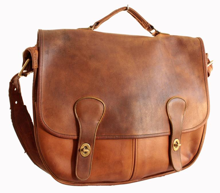 This vintage bag is coined the Swag Bag and was made by Coach Leatherware, most likely in the early 1970s.  In production for only a few years, these bags are extremely rare and hard to find nowadays.  Made from tan saddle leather, there are two