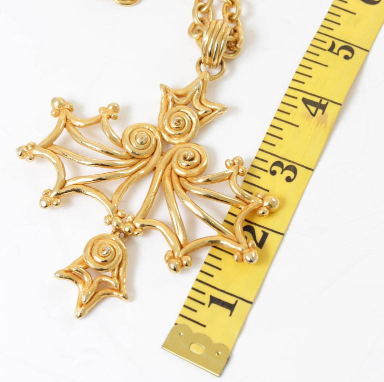 This massive abstract pendant and necklace was made by Sonia Rykiel Paris, most likely in the 1980s.  Made from gold metal, the pendant measures 4in H and the chain is adjustable for up to a 15in drop with a simple hook (total chain length is 30in).