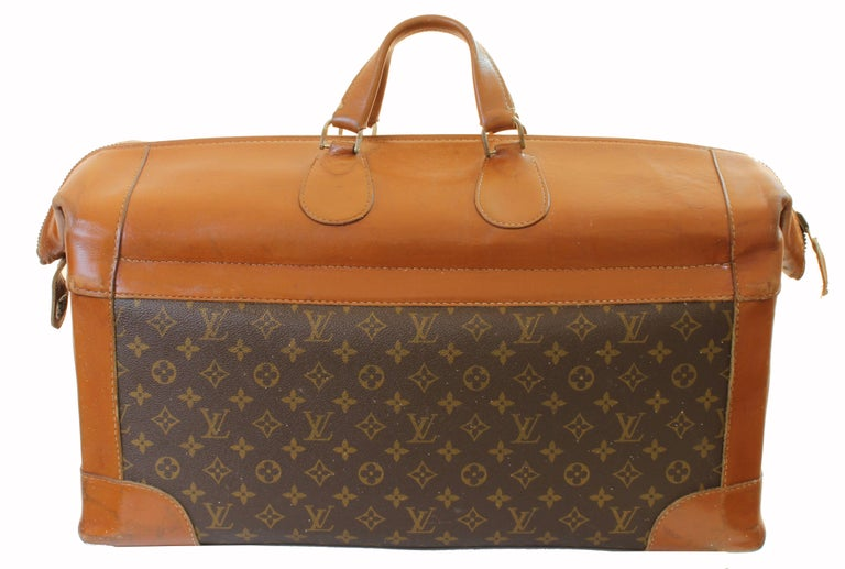 Travel in style with this ultra rare travel bag from Louis Vuitton!  It was made by The French Company under special license from Louis Vuitton, most likely in the early 1970s, and long before LV had a manufacturing presence n the USA. These US made