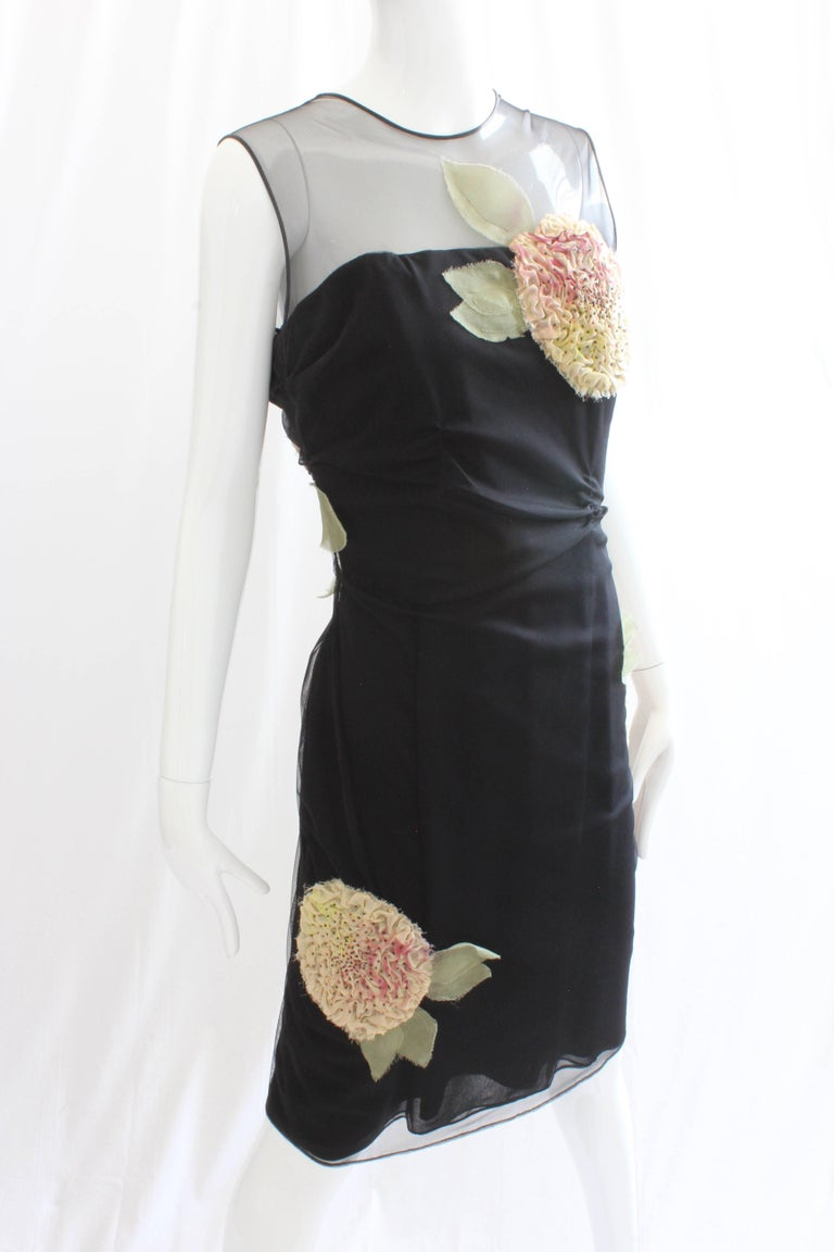 Authentic, preowned and vintage Bill Blass Black Cocktail Dress with Sculptural Florals. Features an inner corset made from black silk satin, which gives the piece great shape and structure. Lined at bodice and skirt/dry clean only. No content