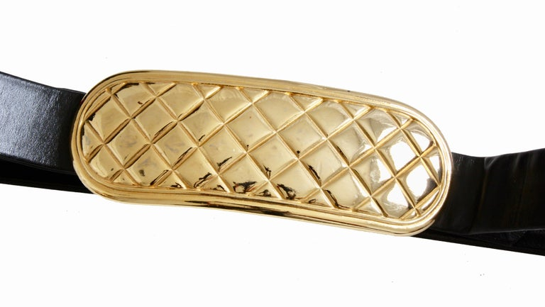 There's nothing like an oversized 80s belt to make a statement, and this rare vintage buckle and belt strap from Accessocraft NYC fits the bill.  Made from gold metal, the bar-shaped buckle features a matelasse quilted pattern and measures 6in L x