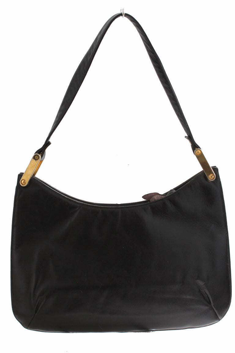 Here's a fabulous black box leather shoulder bag, made for Saks Fifth Avenue, most likely in the 1970s.  It features gold metal accents on the shoulder strap, a zippered fastener and the interior is lined in black leather with one slip pocket and